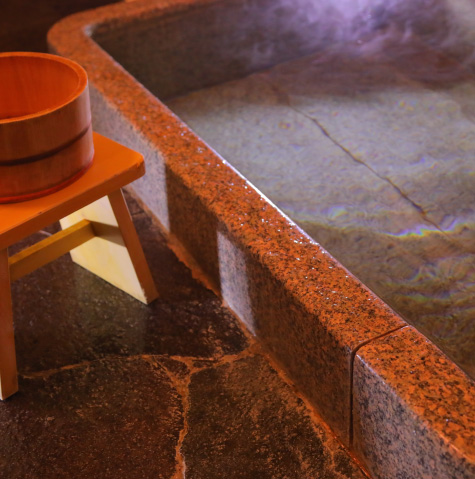 The tub is made of ancient red granite.